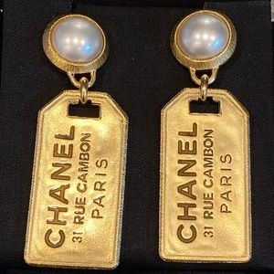 BNIB Chanel gold pearl button tag earrings